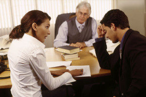 Divorcing Couple Sitting in Lawyer's Office